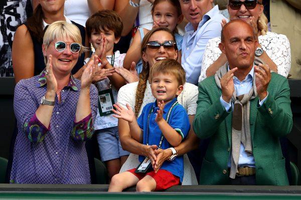 Jelena Djokovic (C), wife of Novak Djokovic of Serbia, and their son Stefan Djokovic applaud