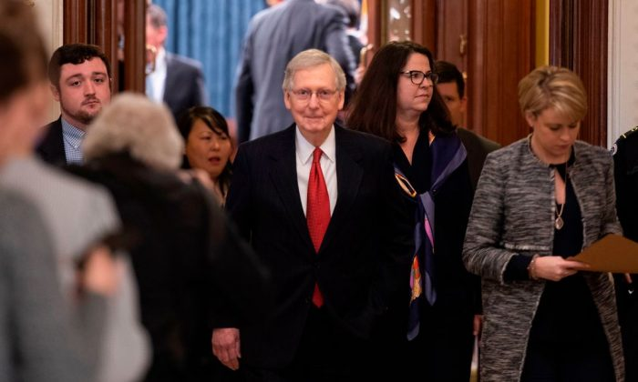 US Senate Majority Leader Mitch McConnell (C) departs the Senate Chamber after votes to reopen the government failed to pass on Capitol Hill in Washington, DC, on Jan. 24, 2019. (JIM WATSON/AFP/Getty Images)