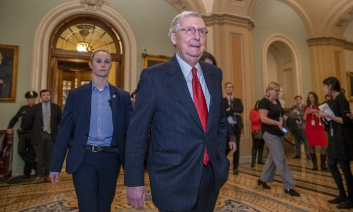 Senate Majority Leader Mitch McConnell, R-Ky., leaves the chamber after Senate Democrats blocked President Donald Trump's request for $5.7 billion to construct his long-sought wall along the U.S-Mexico border, as a partial government shutdown continues, at the Capitol in Washington, Jan. 24, 2019. (AP Photo/J. Scott Applewhite)