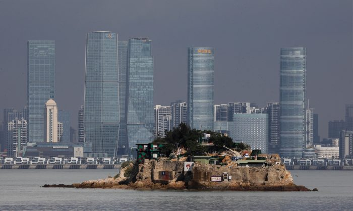 Shiyu, or Lion Islet, which is part of Kinmen county, one of Taiwan's offshore islands, is seen in front of China's Xiamen, on Lieyu island, Kinmen county, Taiwan on Aug. 20, 2018. (Tyrone Siu/Reuters)