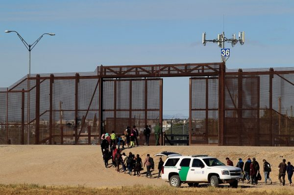 Migrants from Central America are seen escorted by U.S. Customs and Border Protection officials after crossing the border from Mexico to surrender to the officials in El Paso, Texas, U.S., in this picture taken from Ciudad Juarez
