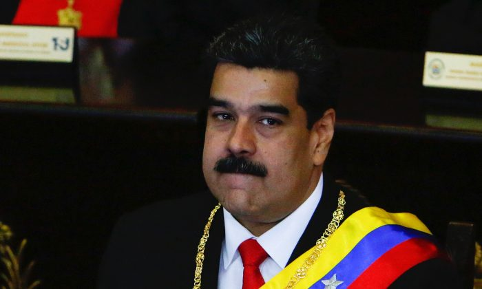 President of Venezuela Nicolás Maduro (L) looks on before talking to judges and members of the Supreme Justice Tribunal on its annual opening day of sessions in Caracas, Venezuela, on Jan. 24, 2019. (Getty Images)