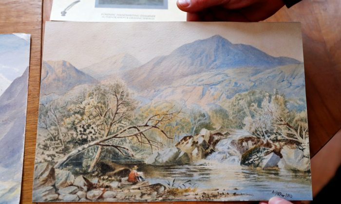 A watercolor of an unknown landscape attributed to Adolf Hitler at Kloss action house, pictured before it was seized by police as a suspected forgery, in Berlin on Jan. 24, 2019. (Reuters/Fabrizio Bensch)