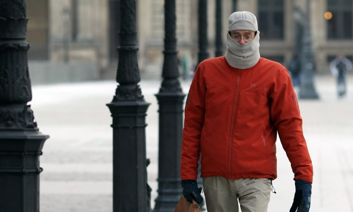 A man walks while bundled up due to the cold in Paris, France on Feb. 6, 2012. (ALEXANDER KLEIN/AFP/Getty Images)