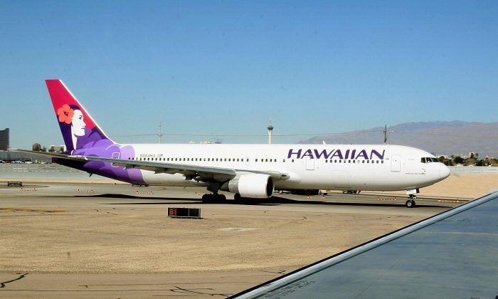 A Hawaiian Airlines flight from Honolulu to New York City was diverted to San Francisco after a male flight attendant died of an apparent heart attack, officials said Jan. 25. (KAREN BLEIER/AFP/Getty Images)