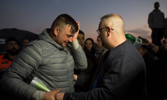 Jose Rosello (L), father of Julen who fell down a well, cries as rescue efforts continue to find the boy in Totalan in southern Spain, on Jan. 16, 2019. (Jorge Guerrero/AFP/Getty Images)