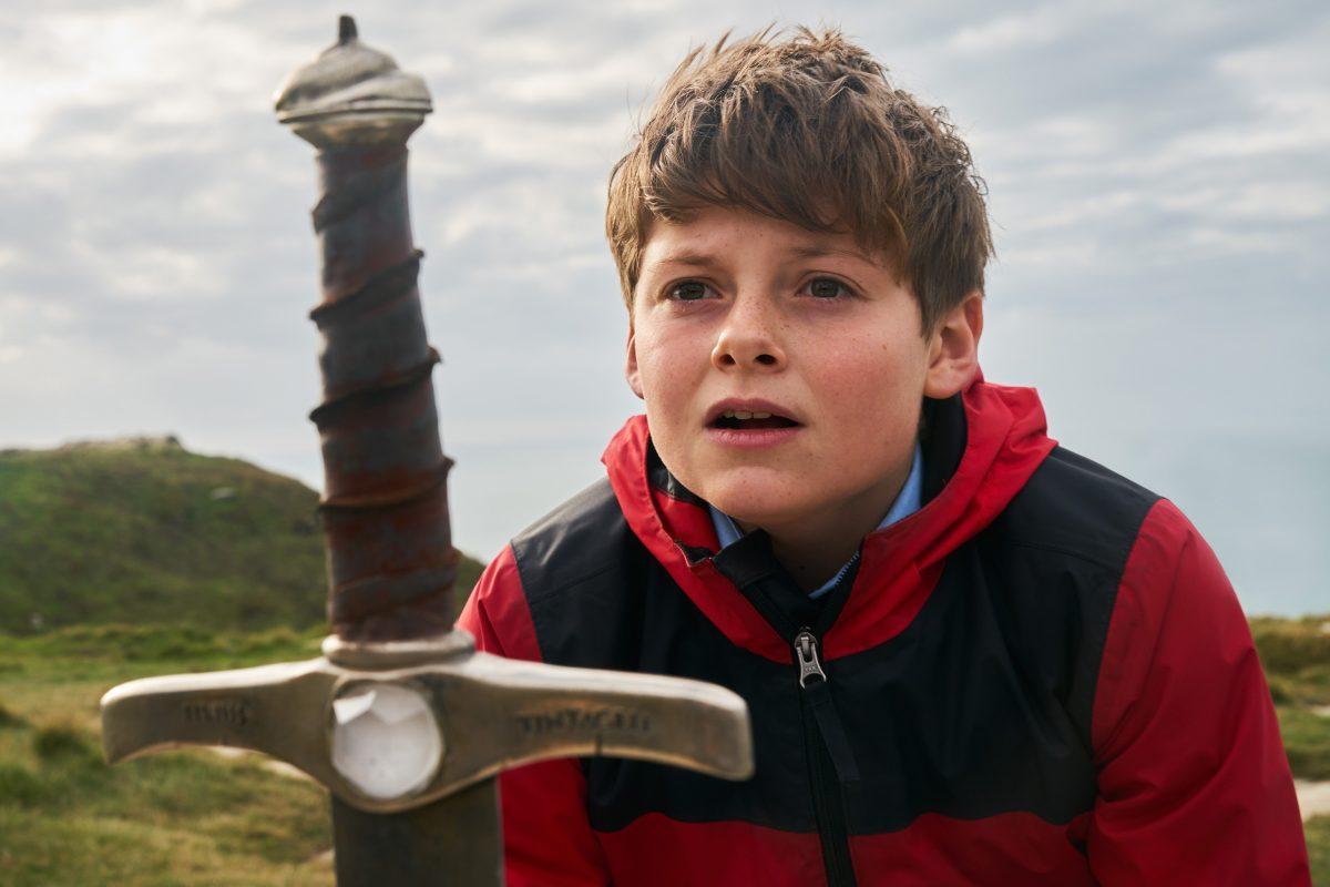 Boy in red coat and sword