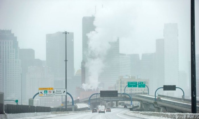 Ice and snow cover Interstate 93 through the city during Winter Storm Harper in Boston, Massachusetts on January 20, 2019. 