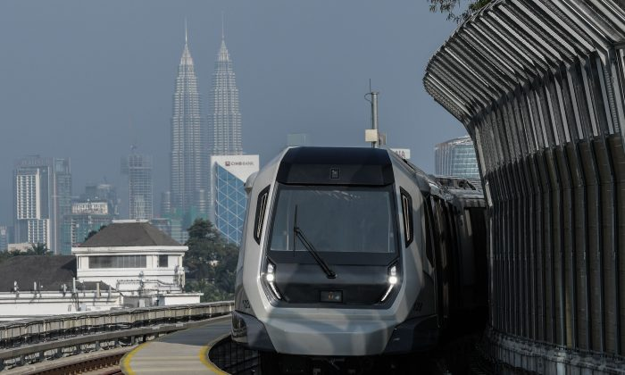 A Malaysia mass transit train against the backdrop of Malaysia's landmark Petronas Twin Towers, in Kuala Lumpur on December 15, 2016. (MOHD RASFAN/AFP/Getty Images)