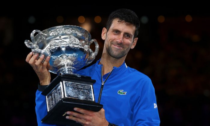 Novak Djokovic of Serbia poses with the Norman Brookes Challenge Cup following his victory in the Men's Singles Final match against Rafael Nadal of Spain at the 2019 Australian Open at Melbourne Park in Melbourne, Australia on Jan. 27, 2019. (Julian Finney/Getty Images)