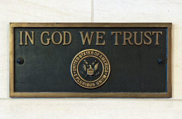 In God We Trust plaque.