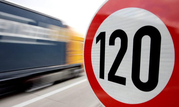 A truck passes a 120 km/h (75 mph) speed limit sign on the A27 Autobahn near the northern German city of Bremen in this file photo. (Reuters/Morris Mac Matzen/File Photo)