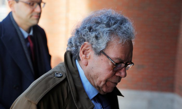 John Kapoor, the billionaire founder of Insys Therapeutics Inc, arrives at the federal courthouse for the first day of the trial accusing Insys executives of a wide-ranging scheme to bribe doctors to prescribe an addictive opioid medication, in Boston, Mass., on Jan. 28, 2019. (Brian Snyder via Reuters)