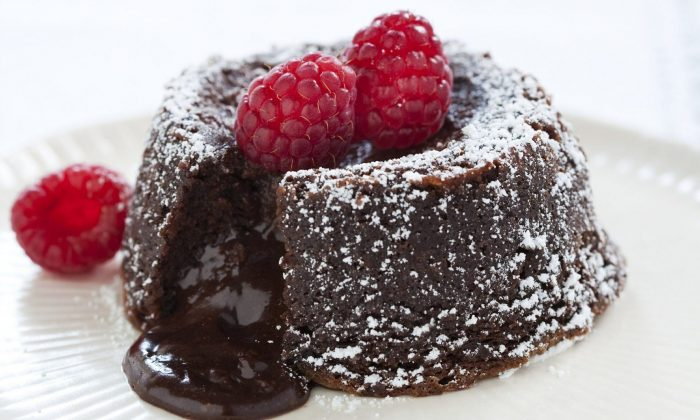 """A Fallen Chocolate Cake in Brookline, Mass. This recipe appears in the cookbook """"The Perfect Cake."""" (Keller + Keller/America's Test Kitchen via AP)"""