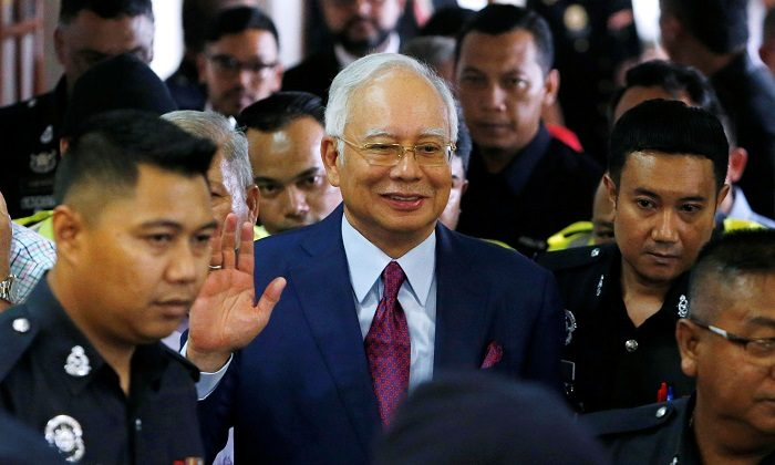 Malaysia's former Prime Minister Najib Razak leaves a courtroom in Kuala Lumpur, Malaysia, ON July 4, 2018. (Lai Seng Sin/Reuters)