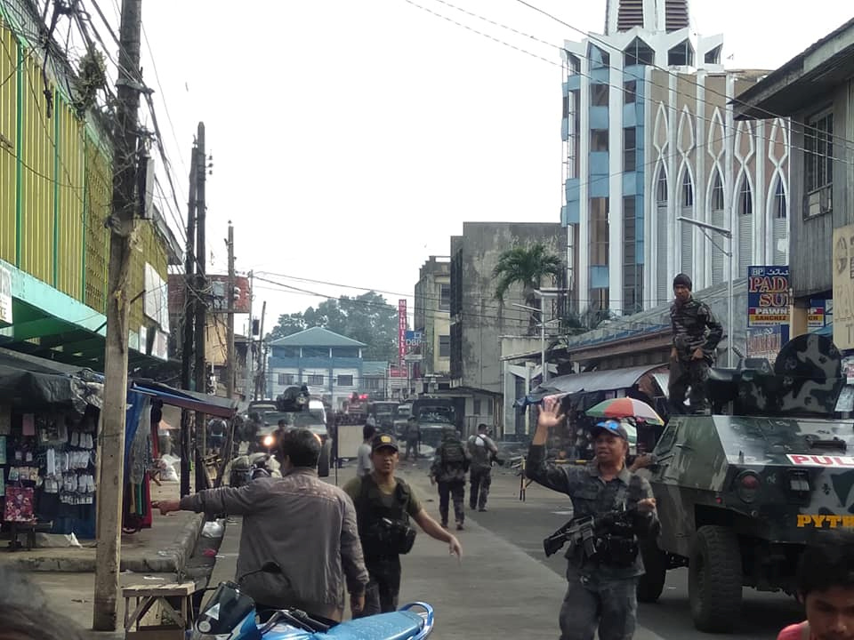 Philippine Army members secure area outside church after bombing attack in Jolo