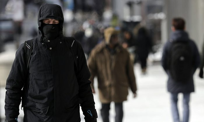 A man is bundled up against the cold in downtown Chicago, on Jan. 27, 2019. (Nam Y. Huh/AP)