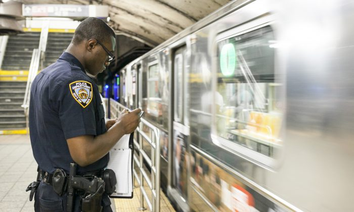 A NYPD officer in a New York City subway station in a file photo. (Samira Bouaou/Epoch Times)