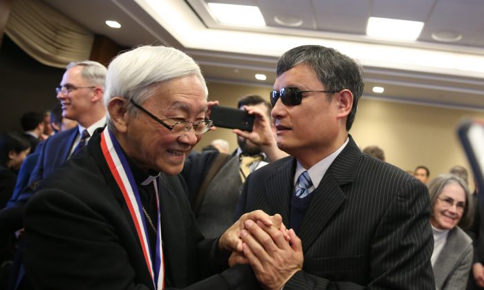 Chen Guangcheng, blind Chinese civil rights activist and lawyer (R), greets Cardinal Joseph Zen, recipient of the Truman-Reagan Medal of Freedom during a ceremony at the Rayburn House Office Building on Capitol Hill in Washington, D.C., on Jan. 28, 2019. (Samira Bouaou/The Epoch Times)
