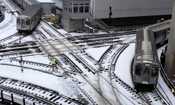 Chicago's El trains move along snow-covered tracks in Chicago, on Jan. 28, 2019. (Kiichiro Sato/AP Photo)