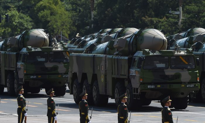 Military vehicles carrying DF-21D missiles are displayed in a military parade at Tiananmen Square in Beijing on Sept. 3, 2015. (Greg Baker/AFP/Getty Images)