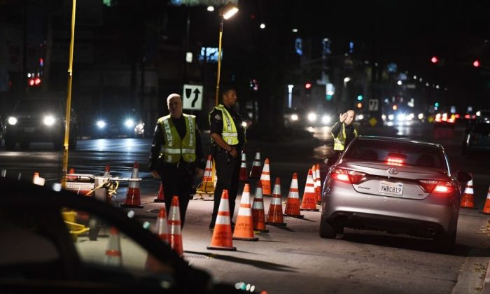 LAPD police check drivers at a DUI checkpoint in Reseda, Los Angeles, Calif., on April 13, 2018. (Mark Ralston/Getty Images)