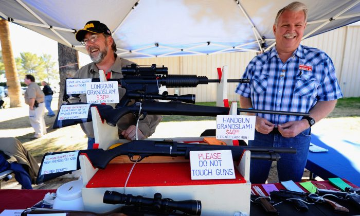 Vendors display hunting rifles for sale at the Crossroads of the West Gun Show at the Pima County Fairgrounds, in Tucson, Ariz., on Jan. 15, 2011.  (Kevork Djansezian/Getty Images)