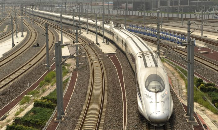 China railway economist pointed out that China high-speed railways can't generate enough revenue even to pay its interests of loans on building them. (PETER PARKS/AFP/Getty Images)