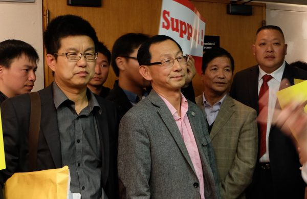 Tao (Thomas) Qu (C) attends a council meeting at the Toronto District School Board on Oct. 1, 2014. Qu (Becky Zhou/Epoch Times)