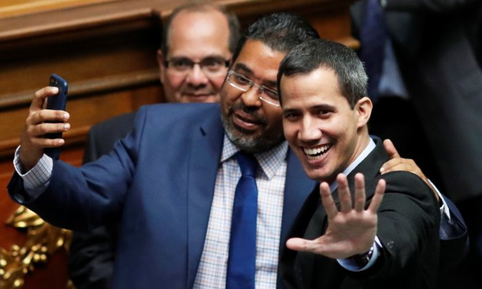 Venezuelan Interim President Juan Guaido (R) at a session of the Venezuela's National Assembly in Caracas, Venezuela, on Jan. 29, 2019. (Carlos Garcia Rawlins/Reuters)