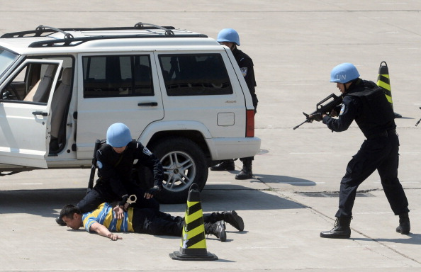 Chinese peacekeeping police take part in drills in Langfang, in northern China's Hebei Province, before they leave for a United Nations peacekeeping mission in Liberia, on May 4, 2014.  (STR/AFP/Getty Images)