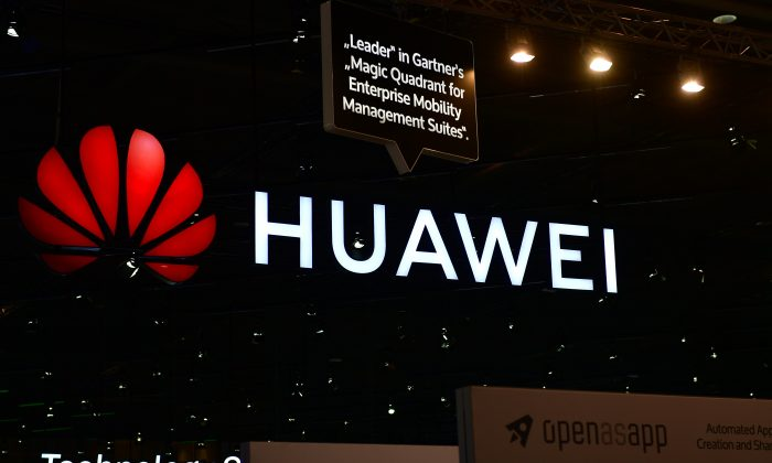 The Huawei logo is displayed in a trade fair on June 12, 2018 in Hanover, Germany. (Alexander Koerner/Getty Images)