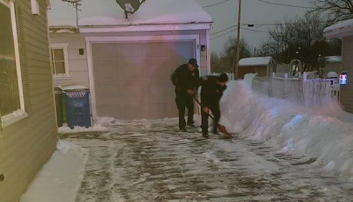 Firefighters were credited with shoveling an Iowa woman's driveway after she gave birth as extremely cold temperatures inundate much of the United States, namely the Midwest. (Cedar Rapids Fire Department/Facebook )