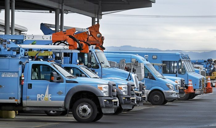 Pacific Gas & Electric vehicles parked at the PG&E Oakland Service Center in Oakland, Calif., on Jan. 14, 2019. (Ben Margot/AP Photo)