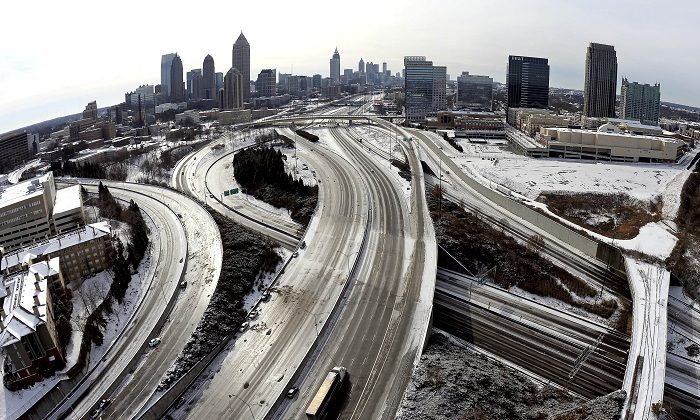 Taken with a fisheye lens looking south toward downtown Atlanta, the ice-covered interstate system shows the remnants of a winter snow storm, in Atlanta, on Jan. 29, 2014. (David Tulis/AP Photo, File)