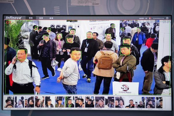 A screen shows visitors being filmed by artificial intelligence security cameras with facial recognition technology at the 14th China International Exhibition on Public Safety and Security at the China International Exhibition Centre in Beijing on Oct. 24, 2018. (NICOLAS ASFOURI/AFP/Getty Images)
