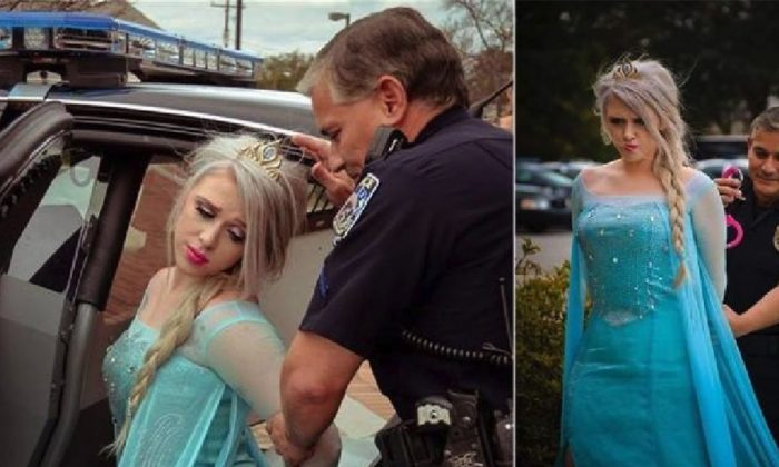 "The McLean Police Department posted photographs of officers appearing to arrest Disney character ""Elsa"" from the film Frozen, as an apparent playful way of marking the bitter polar vortex cold snap. (McLean Police Department)"
