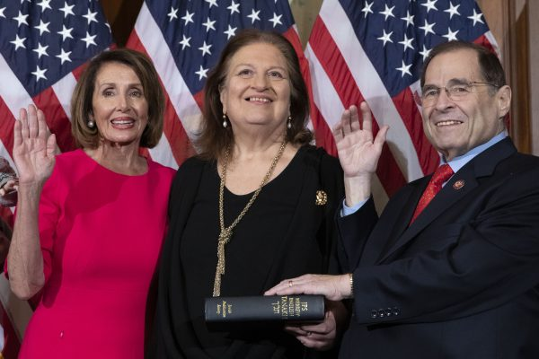 Speaker of the House Nancy Pelosi performs a ceremonial swearing-in