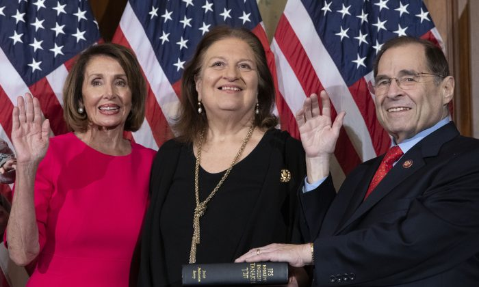Speaker of the House Nancy Pelosi performs a ceremonial swearing-in for Jerry Nadler (D-NY) at the start of the 116th U.S. Congress in Washington on Jan. 3, 2019. (Alex Edelman/AFP/Getty Images)