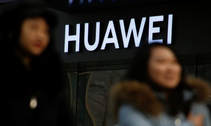 A woman walks past a Huawei shop in Beijing on Jan. 29, 2019. (Thomas Peter/Reuters)