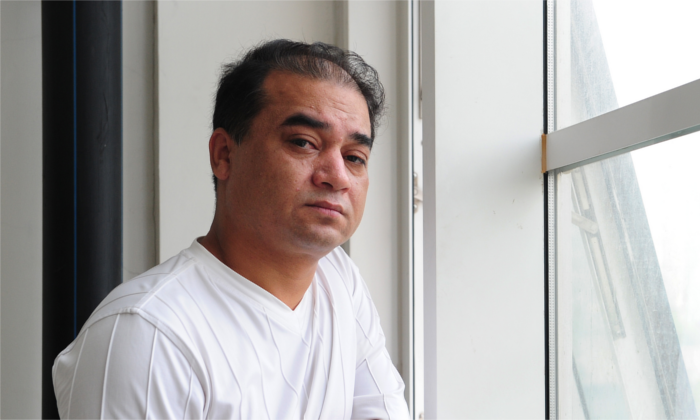 Ilham Tohti pauses before a classroom lecture in Beijing on June 12, 2010. He was nominated for the Nobel Peace Prize on Jan. 30 by two U.S. congressmen. (FREDERIC J. BROWN/AFP/Getty Images)