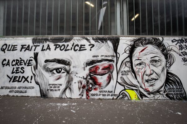 A mural by French artist collective Black Lines depicts a man wounded in the eye