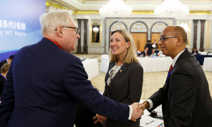 Russian Deputy Foreign Minister Sergey Ryabkov (L) greets U.S. delegation head Undersecretary of State Andrea Thompson (C) and U.S. Permanent Representative to the Conference on Disarmament Robert Wood at a Treaty on the Non-Proliferation of Nuclear Weapons (NPT) conference with the U.N. Security Council's five permanent members (P5) China, France, Russia, Britain, and the United States, in Beijing, Jan. 30, 2019. (Thomas Peter/Reuters)