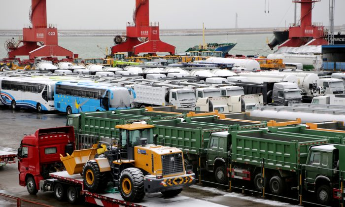 Snow-covered trucks, buses and machineries are seen at a port in Lianyungang, Jiangsu Province, China on Jan. 31, 2019. (Reuters)