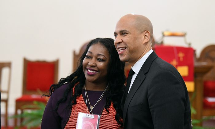 Sen. Cory Booker (R), D-N.J., stops for a photo before a Martin Luther King Jr. prayer service at Zion Baptist Church in Columbia, S.C. on Jan. 21, 2019. (AP Photo/Meg Kinnard)
