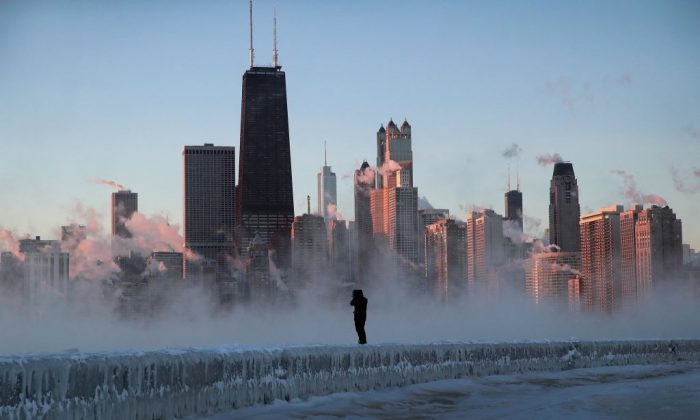 A man walks along an ice-covered break-wall along Lake Michigan while temperatures were hovering around -20 degrees and wind chills nearing -50 degrees in Chicago, Illinois, on Jan. 31, 2019. (Scott Olson/Getty Images)
