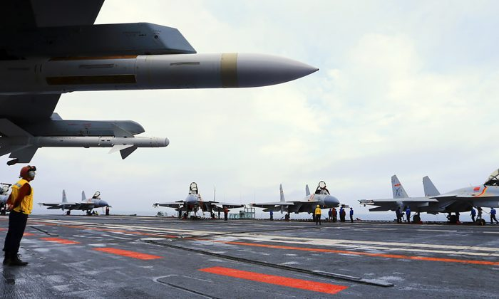 J15 fighter jets on China's sole operational aircraft carrier, the Liaoning, during a drill at sea in April 2018. Huawei's corporate vice president has encouraged staff to innovate to the level of U.S. defense manufacturers. (AFP/Getty Images)
