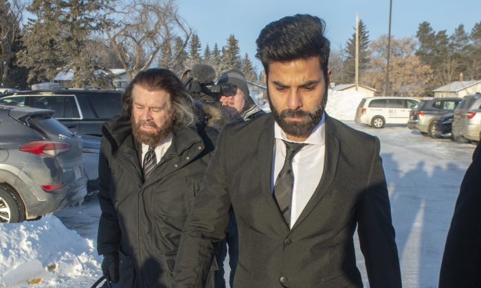 Jaskirat Singh Sidhu, right, the driver of the truck that struck the bus carrying the Humboldt Broncos hockey team, arrives with his lawyer Mark Brayford for the third day of his sentencing hearing in Melfort, Sask, on Jan. 30, 2019. (The Canadian Press/Ryan Remiorz)