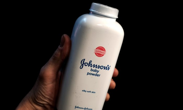 A bottle of Johnson and Johnson Baby Powder is seen in a photo illustration taken in NewYork on Feb. 24, 2016. (Mike Segar/Illustration/Reuters)
