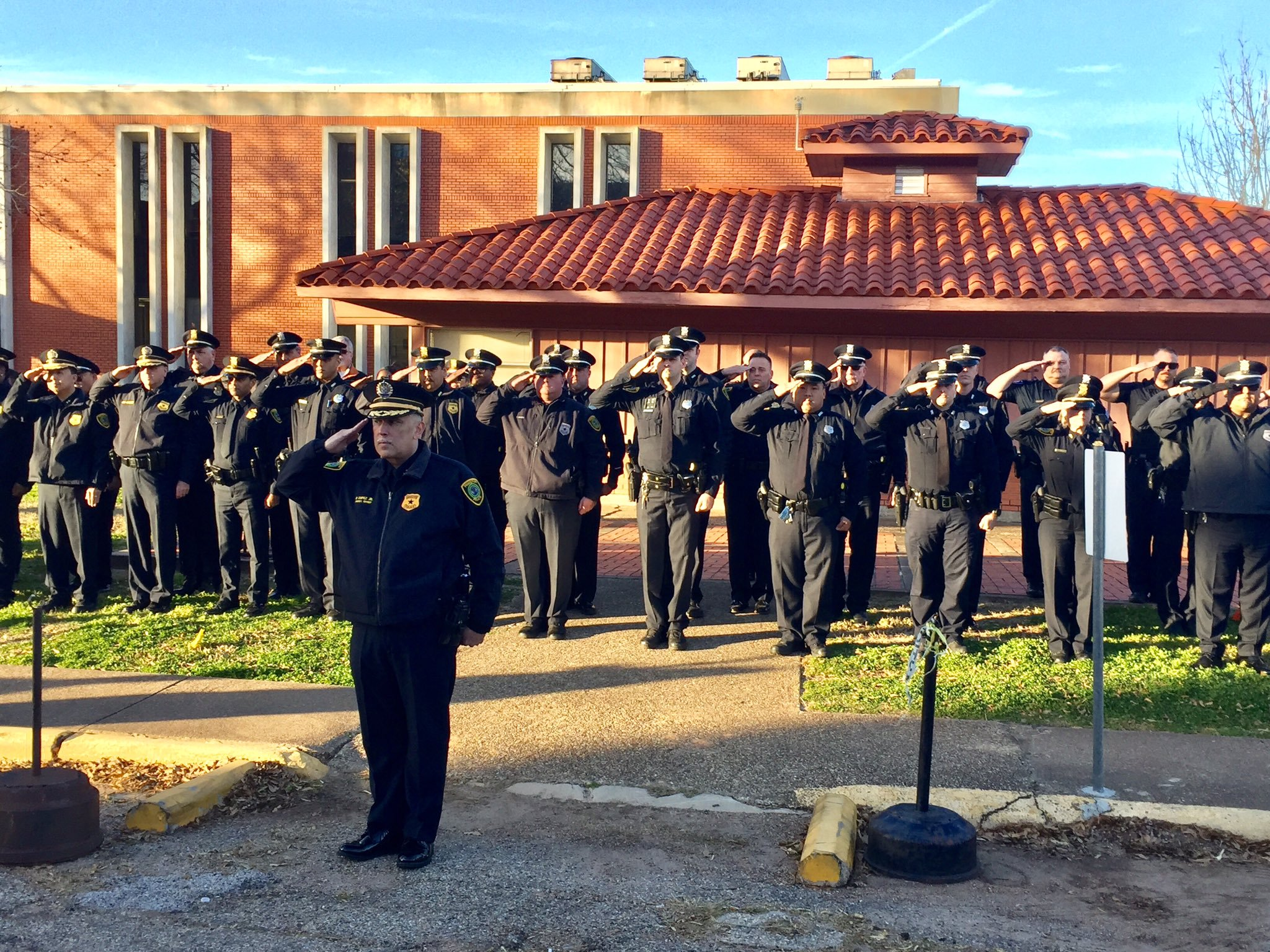 Officer salute outside the prison during the execution of Robert Jennings.